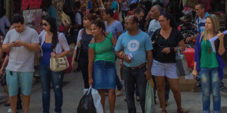 People standing at a crossroad on a busy street in Brazil - Photo by Gabriel Périssé from Pexels'